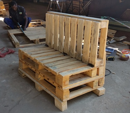 Constructing a bench from used pallets at Nabana Lodge near Hazyview and Kruger National Park