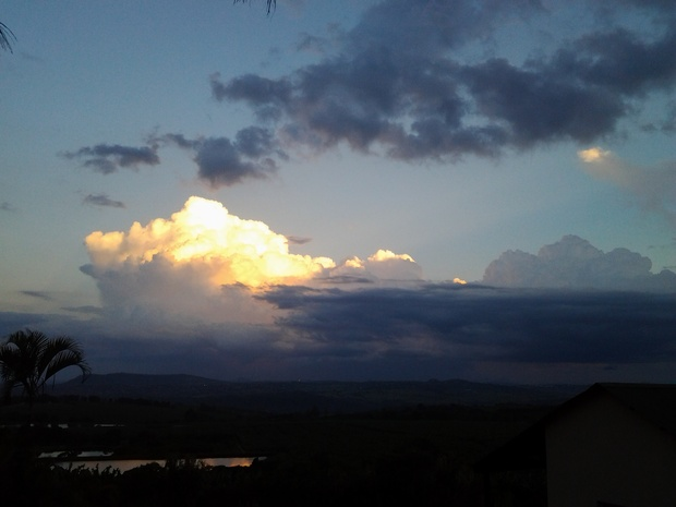 Gold infused clouds at sunset over Nabana Lodge