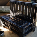 bench constucted from used pallets with finishing coat of paint at Nabana Lodge