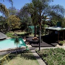 Drone image of gardens, pool and restaurant deck at Nabana Lodge near Kruger National Park and Panorama Route
