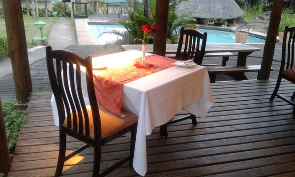 Romantic dinner on the deck of Thyme restaurant at Nabana Lodge