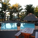 Outdoor swimming pool to cool down on hot summer days at Nabana  Lodge