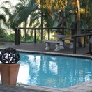 Relax at the Outdoor Swimming Pool at Nabana Lodge