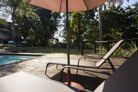 Accommodation Lodge in Hazyview outdoor pool deck, Nabana Lodge outdoor pool deck