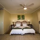 Twin en-suite room at Nabana Lodge, surrounded by banana farms with view towards the Kruger National Park