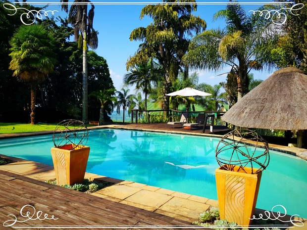 OUtdoor pool and gardens at Nabana Lodge near Hazyview, close to Phabeni and Numbi gate to Kruger National Park